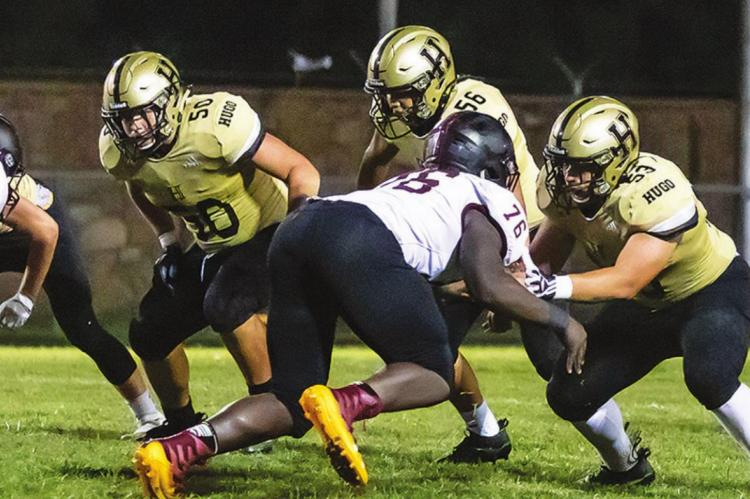 Battle in the trenches... HUGO BUFFALO LINEMAN worked hard in the trenches against Atoka, and performed well on both sides of the football. Above, Caleb Joe, Kameron Allred and Noah Joe keep Atoka players away from Hugo's quarterback. Hugo News Photo / Bobby Hamill