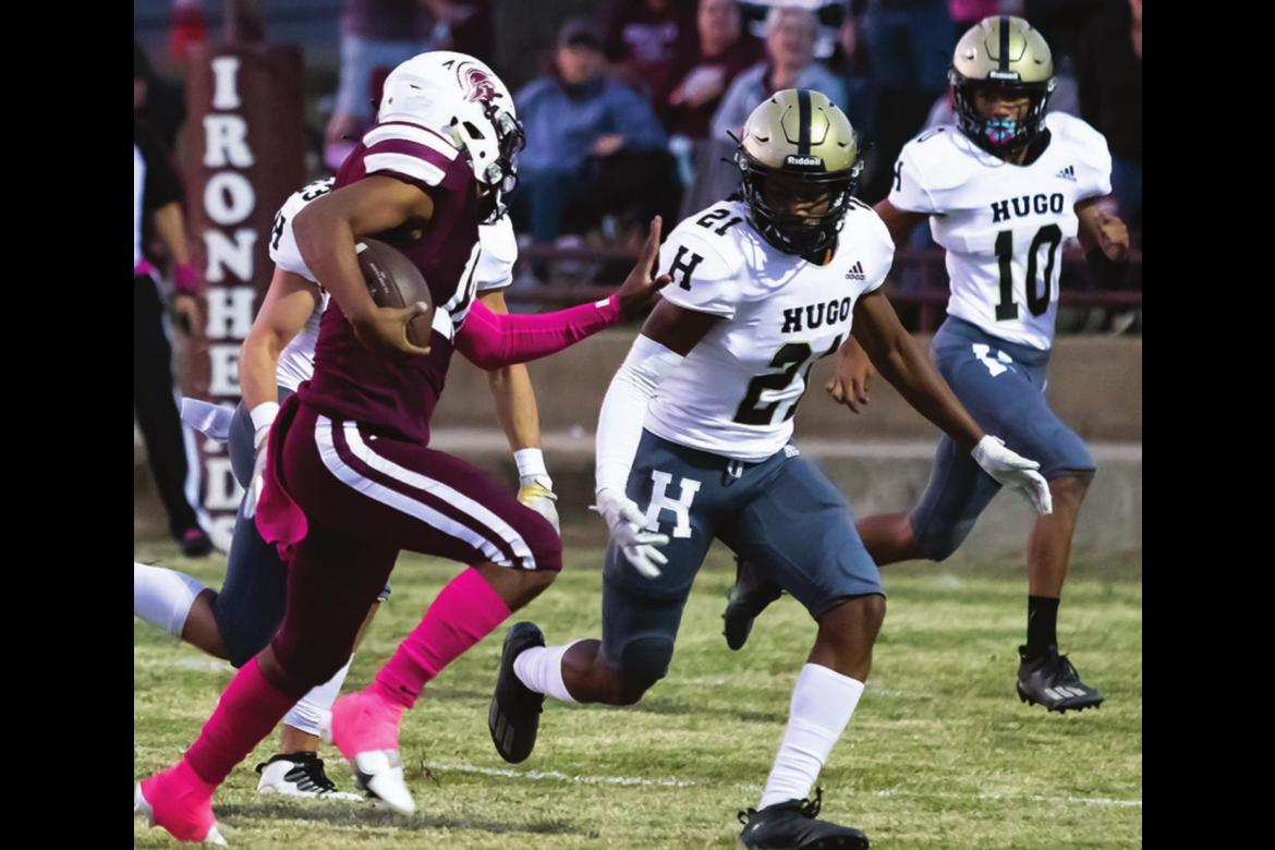 No place to run... ZAN COOK shows great position and coverage from his defensive corner position for the Hugo Buffaloes to contain Eufaula's running back. Backing Cook up is Buffalo Safety LaMarcus Davis, who had two interceptions for the Buffaloes. Hugo News Photos / Bobby Hamill