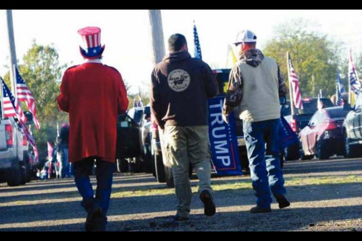 A MAN DRESSED as Uncle Sam walks with two other parade participants at the Hugo Agriplex on Oct. 31 prior to rolling out as part of a Trump train. Photo Courtesy / Sonya Campbell