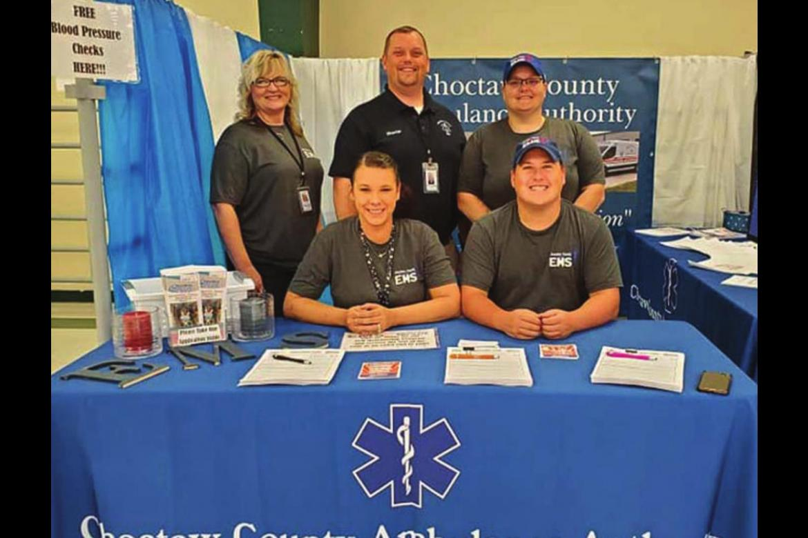 CHOCTAW COUNTY Ambulance Authority Executive Director Randy Springfield (back row, center) stands by other representatives of the agency who manned a booth at the County Fair this past week.